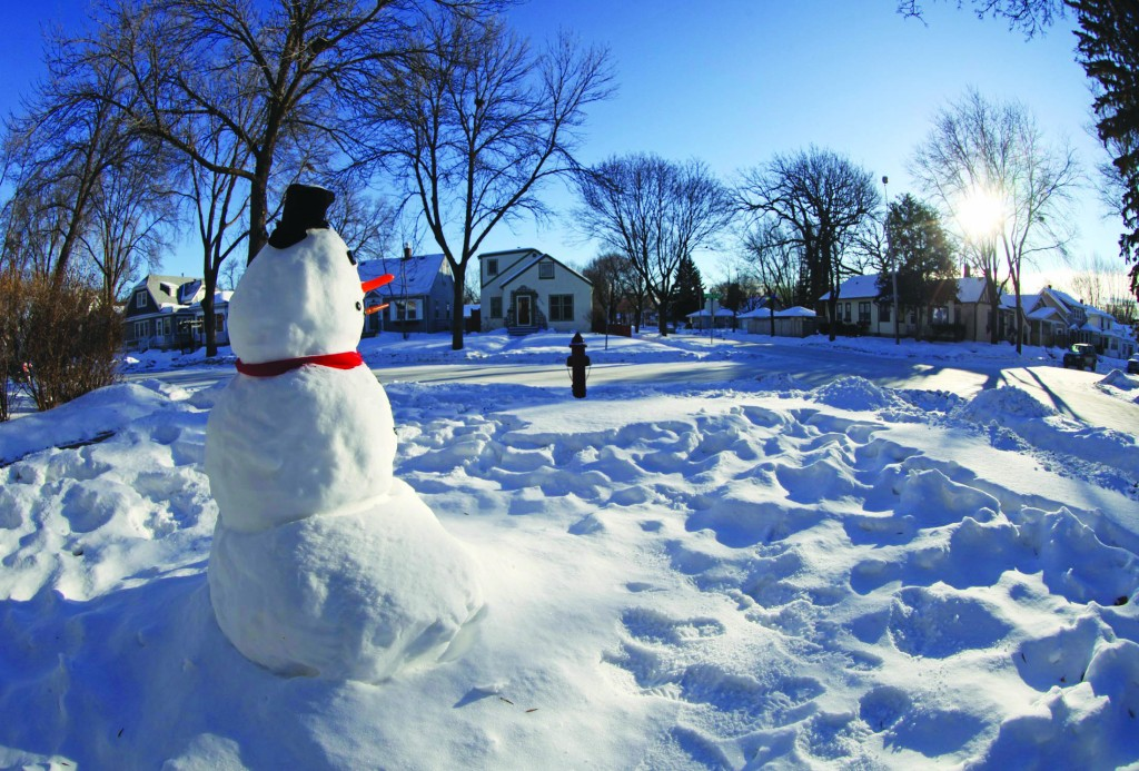 "Minneapolis, Minnesota  A snowman faces east in the yard of a home. Minneapolis public schools were to be closed for a second day on Tuesday ""due to extremely cold temperatures,"" after Gov. Mark Dayton declared a state of emergency on Monday."