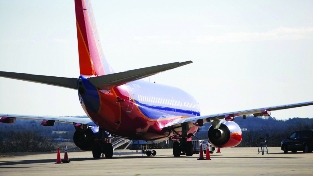 Southwest Airlines Flight 4013 sits at the M. Graham Clark Downtown Airport in Hollister, Mo., Monday. (AP Photo/Springfield News-Leader, Valerie Mosley)
