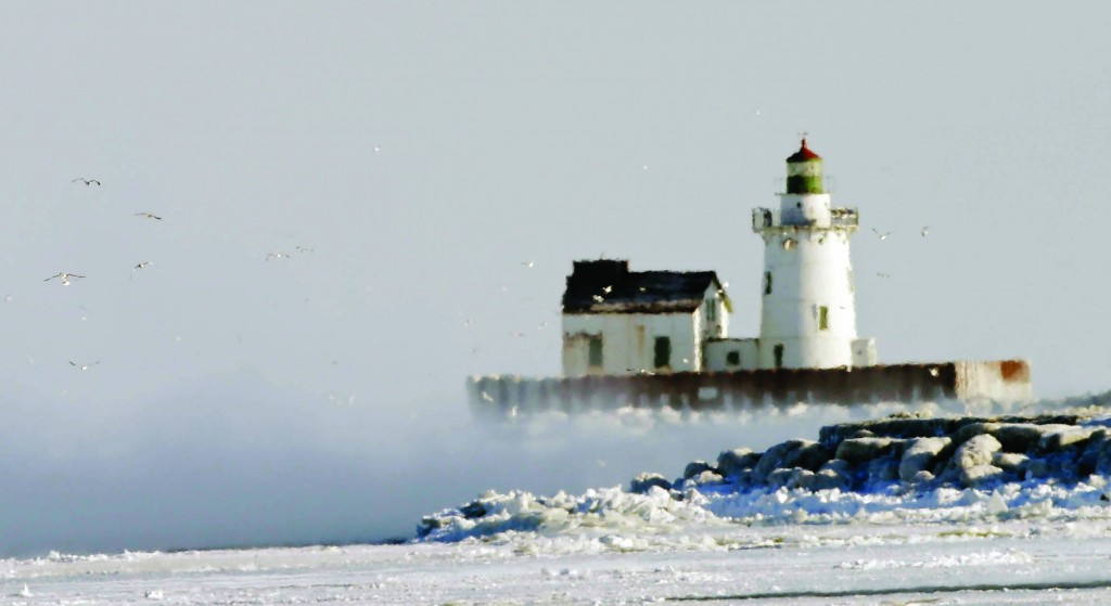 Cleveland, Ohio  Ice fog partially shrouds the lighthouse at the entrance to Cleveland Harbor Tuesday. An official low of -11 degrees in Cleveland broke the old record of -9 set in 1884.