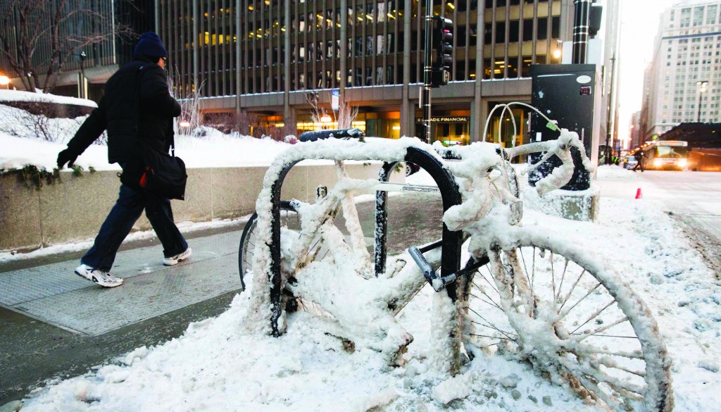 Chicago, Illinois  A man walks past a snow-encrusted bicycle with wind chills nearing minus 30 Fahrenheit on Tuesday in downtown Chicago.