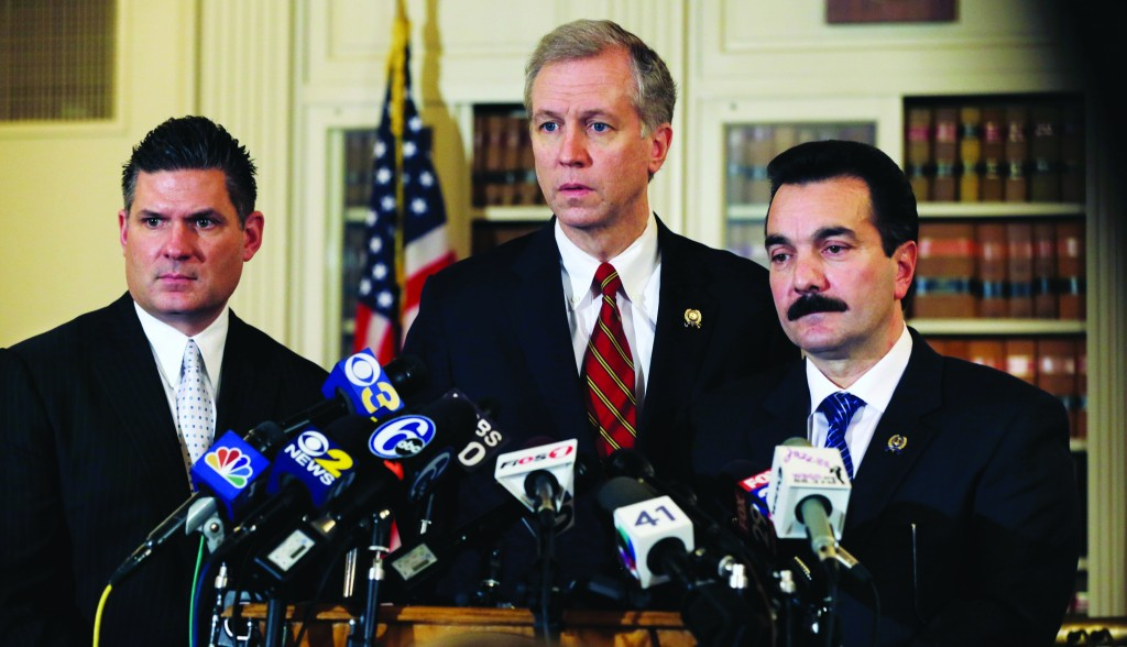 New Jersey Democratic Assemblymen John Wisniewski (C), Lou Greenwald (L), and incoming Speaker Vincent Prieto (R), address the media Monday on the traffic jams. (AP Photo/Mel Evans)