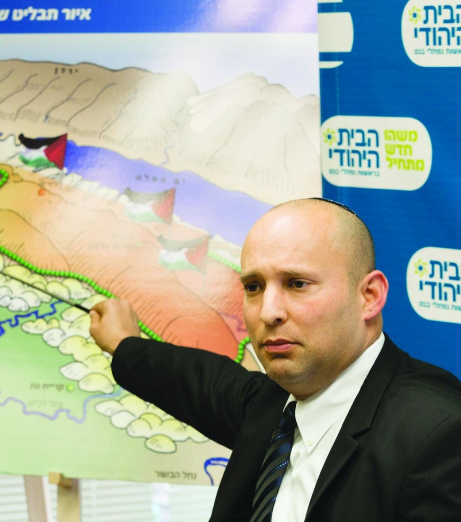 Chairman of the Jewish Home party, Naftali Bennett, pointing to an illustration of a Palestinian state over the map of the state of Israel, and a graph showing economic growth and security in the region. (Flash 90)
