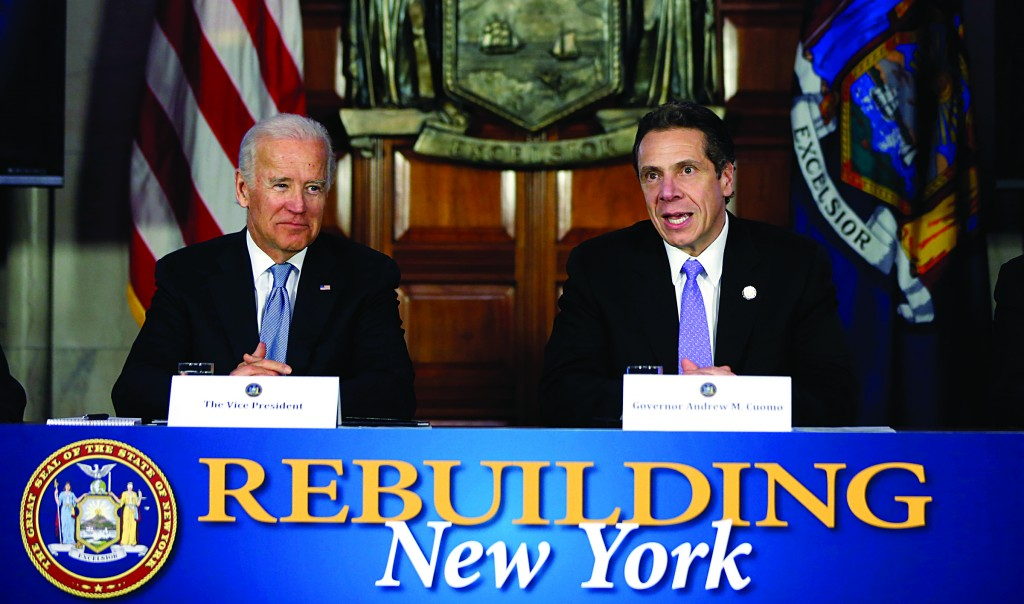 Gov. Andrew Cuomo, right, accompanied by Vice President Joe Biden, during a discussion on the state's rebuilding efforts following Superstorm Sandy in the Red Room at the Capitol, on Tuesday. (AP Photo/Mike Groll)