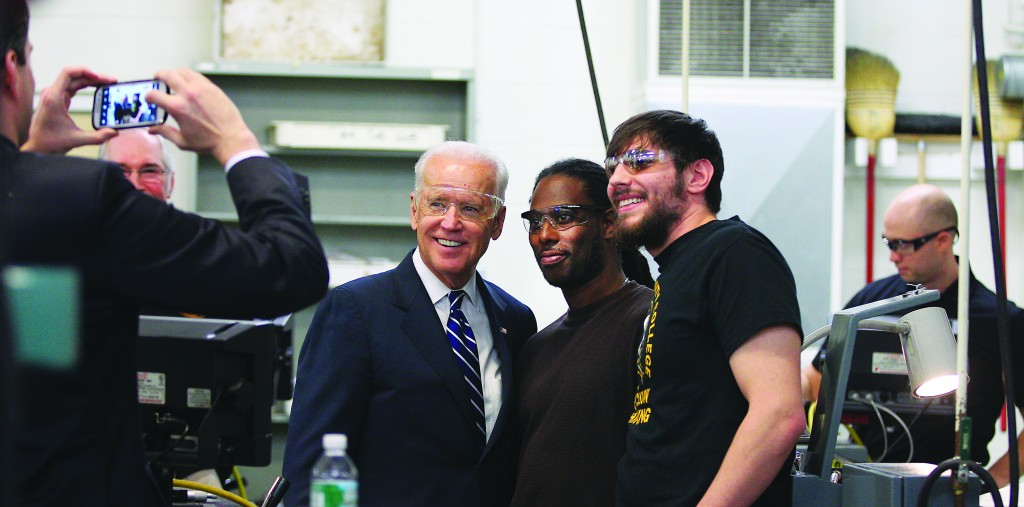 Vice President Joe Biden stops to pose for a photo with students at Monroe Community College Wednesday. (AP Photo/Democrat & Chronicle, Jamie Germano)