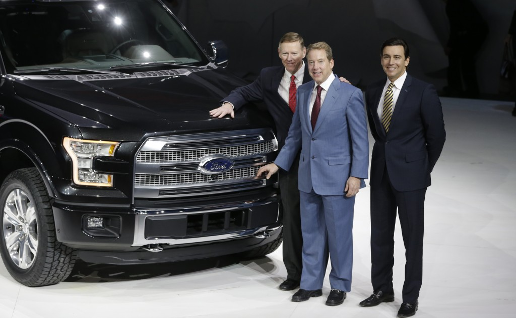 Alan Mulally, President and CEO of the Ford Motor Co., left, Executive Chairman Bill Ford, center, and COO Mark Fields stand next to the new Ford F-150 truck at the North American International Auto Show in Detroit, Monday. (AP Photo/Carlos Osorio)
