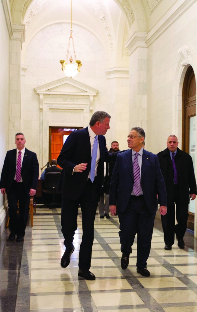 Mayor Bill de Blasio (L) and Assembly Speaker Sheldon Silver (R) in a hallway at the Capitol on Wednesday. (AP Photo/Mike Groll)