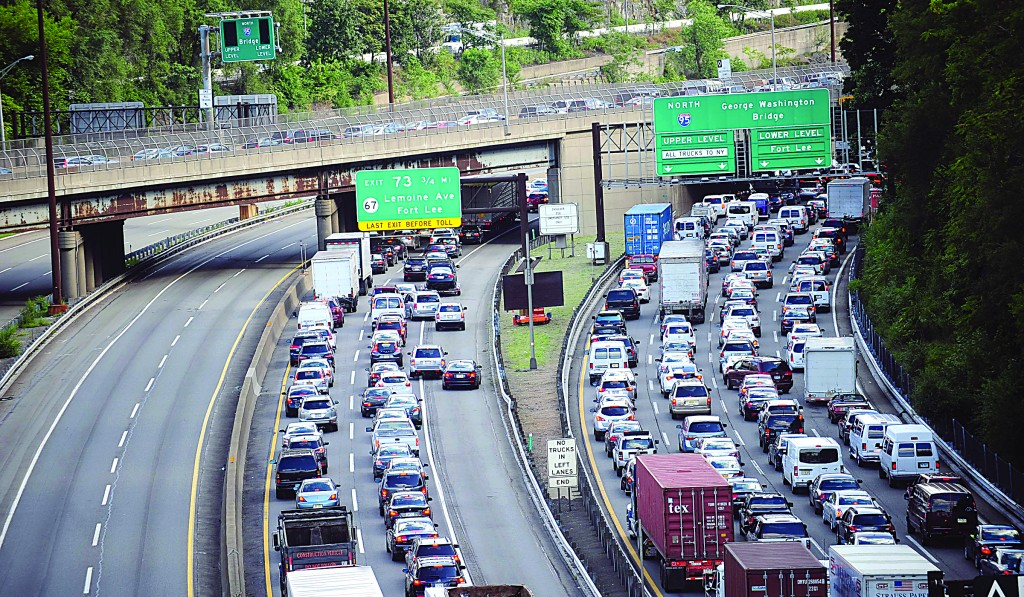 Heavy traffic builds on the approach to the George Washington Bridge near Fort Lee, N.J. on Aug. 15, 2013. (AP Photo/The Record, Marko Georgie - Louis Lanzano)