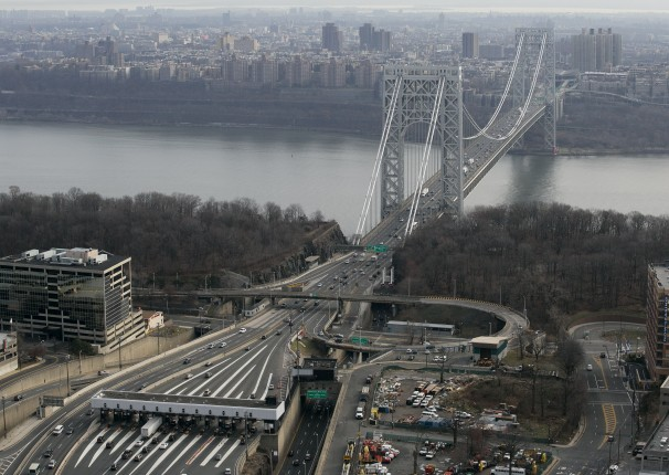 Tollbooth lanes, lower left, lead to the George Washington Bridge in Fort Lee, N.J. (AP Photo/Mark Lennihan)