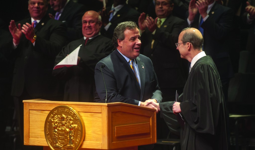 Gov. Chris Christie on Friday is greeted by Chief Justice Stuart Rabner during the swearing-in ceremony for Faustino Fernandez-Vina (on Christie's left. (AP Photo/Courier-Post, Denise Henhoeffer)