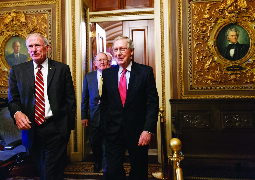 Senate Minority Leader Mitch McConnell (R-Ky.) (C), joined by Sen. Dan Coats (R-Ind.) (L), and Sen. Lamar Alexander, (R-Tenn.) (rear), emerge from a closed-door GOP caucus luncheon at the Capitol in Washington, Tuesday. (AP Photo/J. Scott Applewhite)