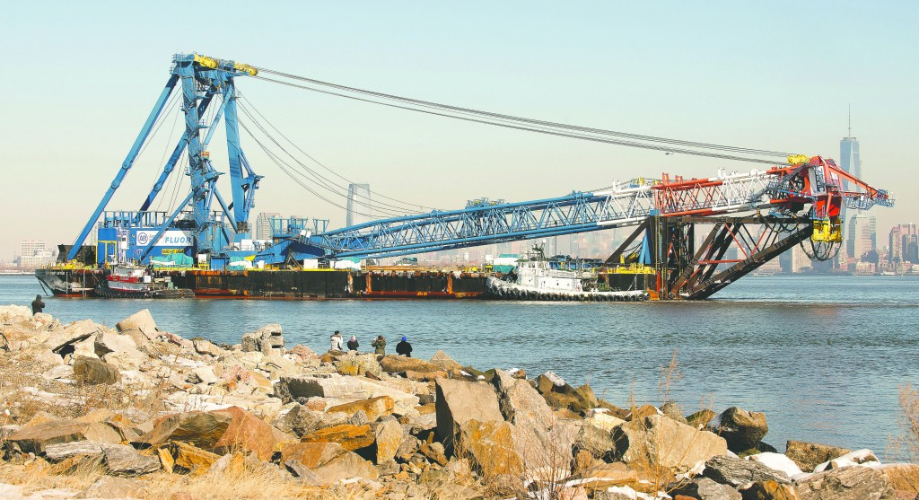 The 400-foot long monster crane makes its way along the Hudson River on its way to port Thursday in Jersey City, N.J. (AP Photo/The Jersey Journal, Reena Rose Sibayan)