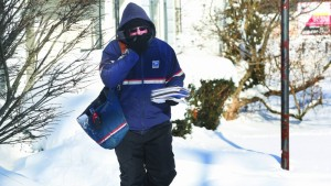 Mail carrier Dan Matranga walks in the snow while delivering the mail in Mundelein, Ill. in the frigid cold Monday, Jan. 6. 'I've been doing this for 34 years,' said Matranga as he trudged through the snow. 'I have to pay the bills. It's not easy, but you deal with it.' (AP photo / Daily Herald, Gilbert R. Boucher II)