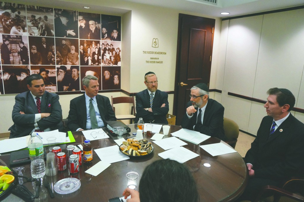 Councilman Chaim Deutsch on Wednesday laid out his vision for the newly created Council subcommittee for Nonpublic Education, which he has been appointed to chair, at a meeting of the Committee of NYC Religious and Independent School Officials at Agudath Israel's Manhattan office. (L-R): Michael Coppotelli and Timothy McNiff, Archdiocese of New York; Dovid Tannenbaum and Rabbi Chaim Dovid Zwiebel, Agudath Israel; and Councilman Deutsch. (Agudath Israel)