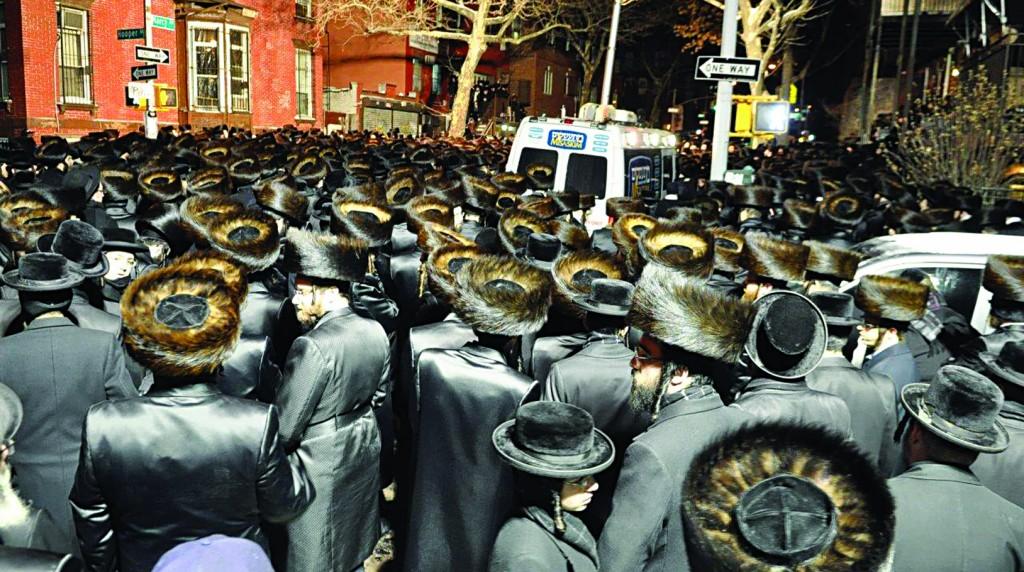 "Throngs of grieving mourners fill the streets of Williamsburg on Motzoei Shabbos for the levayah of Reb Menachem Stark, Hy""d. (JDN/Menachem Stark Family)"