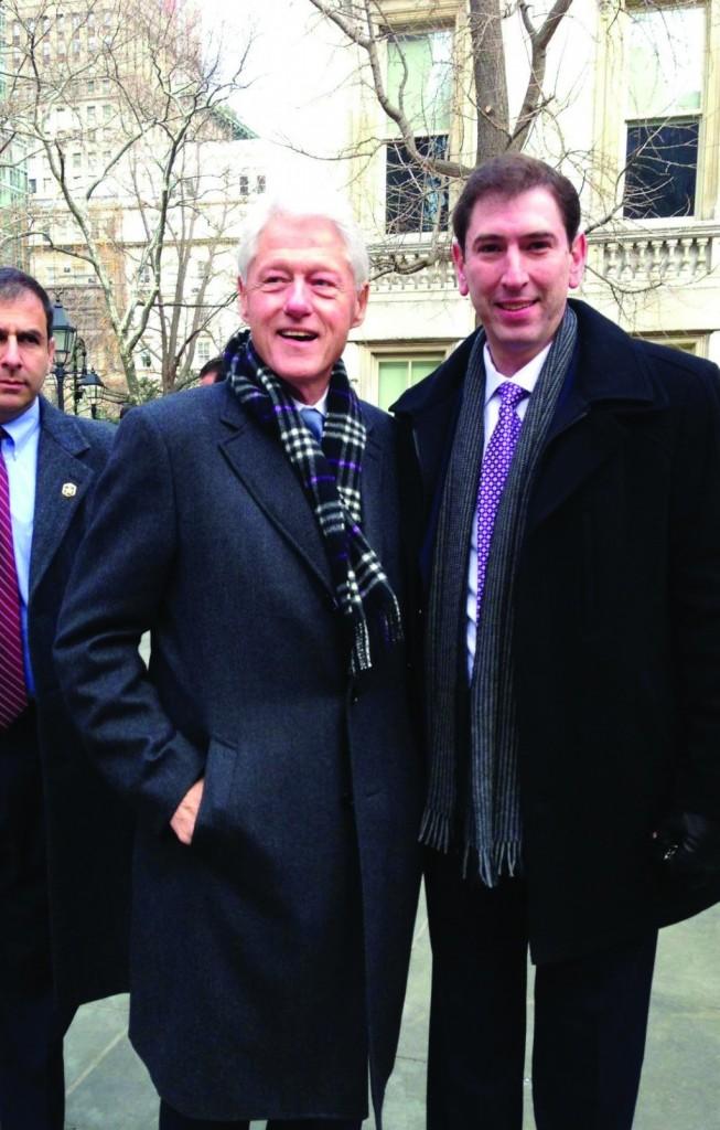 Councilman Chaim Deutsch (D-Flatbush) posing Wednesday with former President Bill Clinton at Mayor Bill de Blasio's inauguration.