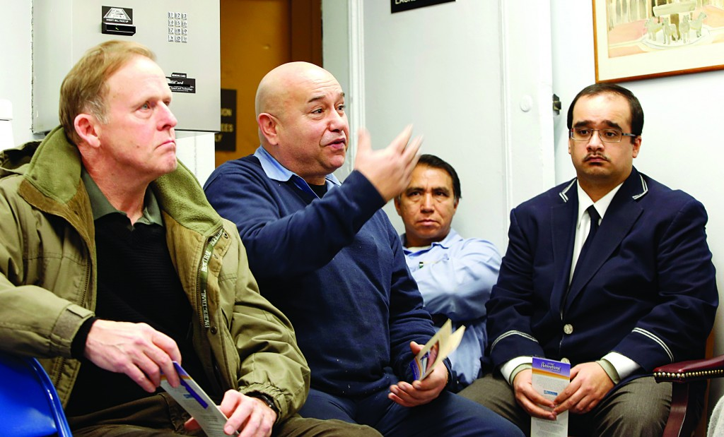 Doorman/porter Ismael Gonzalez speaks during a class teaching doormen and building staff how to identify and what to do if they spot cases of elder abuse, at an Upper East Side condominium. (AP Photo/Kathy Willens)