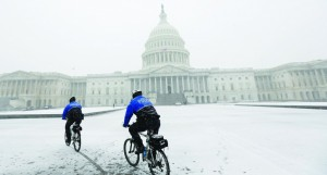 Police on mountain bikes patrol in the snow in front of the U.S. Capitol in Washington. (REUTERS/Kevin Lamarque)