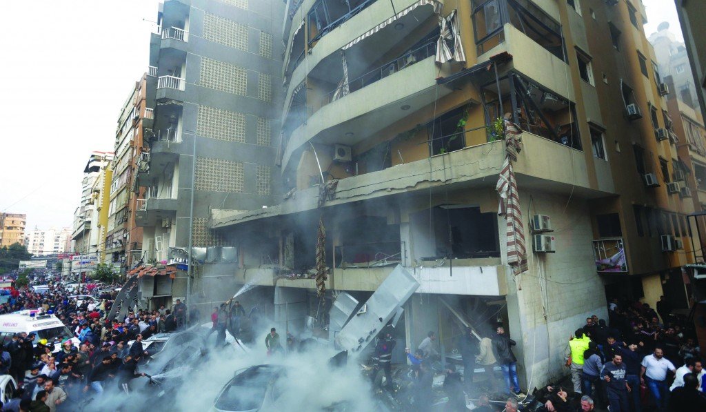 Lebanese citizens gather at the site of an explosion in a stronghold of Hizbullah at the southern suburb of Beirut, Lebanon, Thursday. (AP Photo/Hussein Malla)