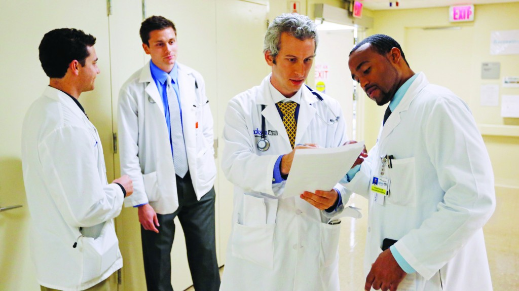 Doctors Jordan Klein (2nd R) and Chane Price (R) confer as University of Miami interns Ignatios Papas (L) and Tim Sterrenberg (2nd L) look on in the Rehabilitation Unit of Jackson Memorial Hospital in Miami. (REUTERS/Joe Skipper/Files)