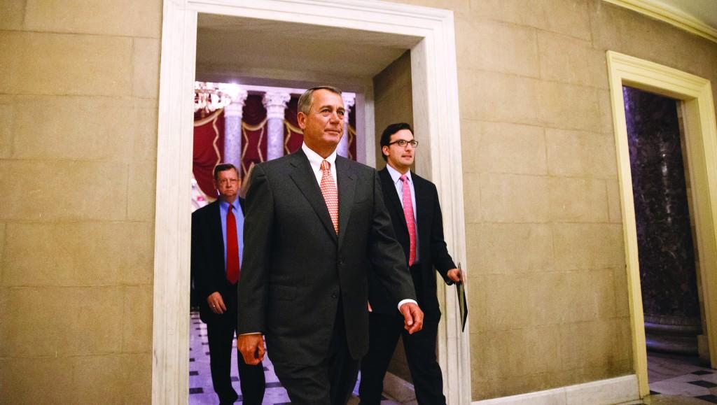House Speaker John Boehner of Ohio leaves the House chamber on Capitol Hill in Washington, Wednesday, after the final vote on the spending bill. ( AP Photo/J. Scott Applewhite)