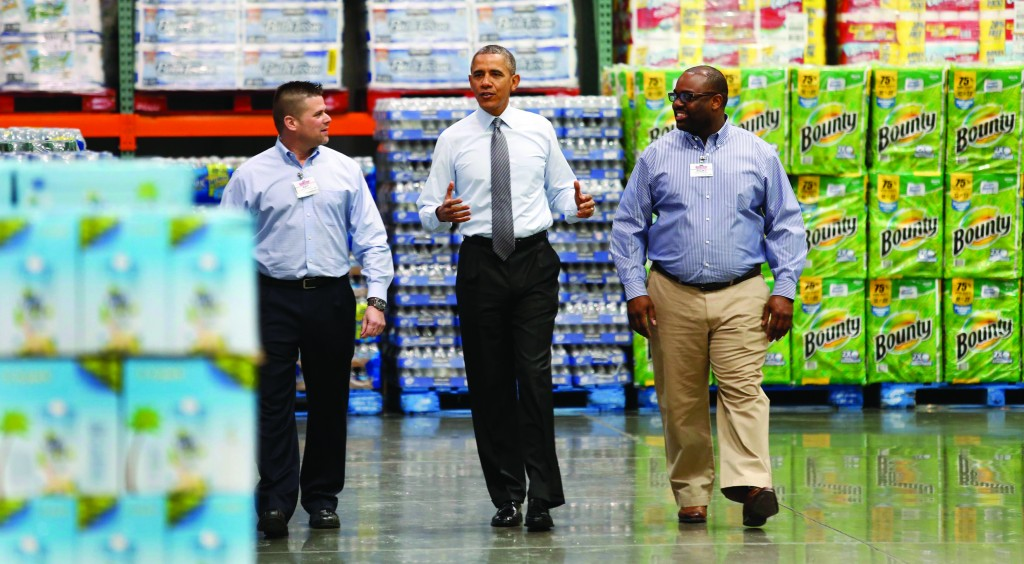 President Obama walks between Emile (Ray) Quevedo (L) and Ricky Banner, Assistant General Manager, as he tours Costco Wholesale in Woodmore Town Center in Lanham, Maryland. (REUTERS/Yuri Gripas)