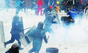 A police officer beats a protester during clashes in central Kiev, Ukraine, Wednesday. (AP Photo/Sergei Grits)