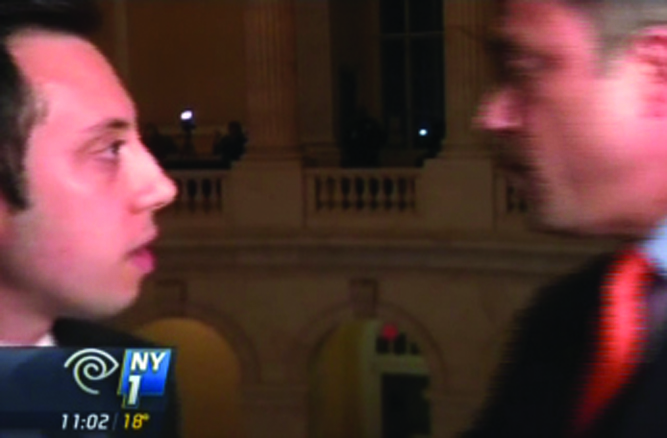 Rep. Michael Grimm confronts NY1 reporter Michael Scotto Tuesday night in the Capitol in Washington.