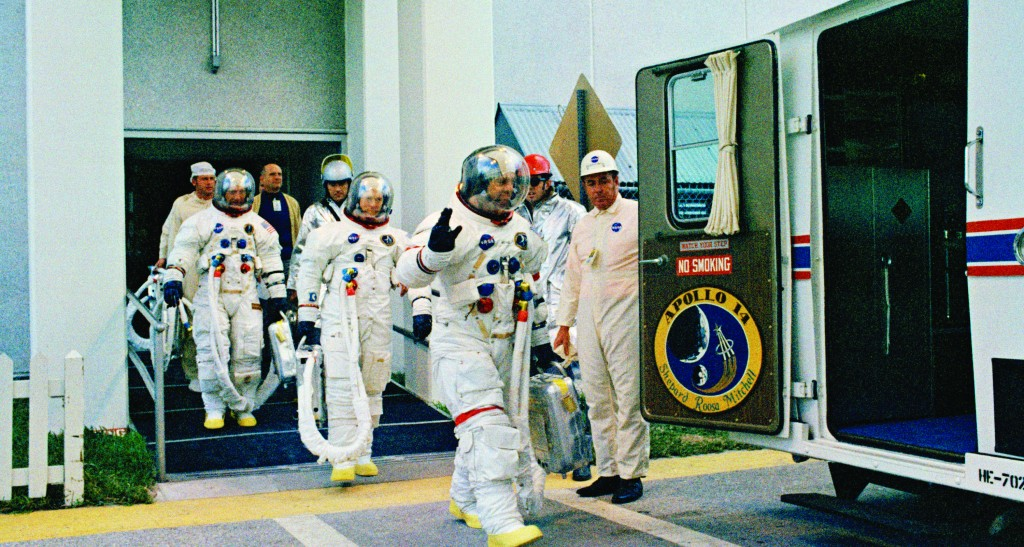 Apollo 14 astronauts Alan Shepard (front), Stuart Roosa, and Edgar Mitchell (back), walk to a transfer van for a countdown demonstration test, Jan. 19, 1971, Kennedy Space Center, Brevard County, Fl. (AP Photo/NASA)