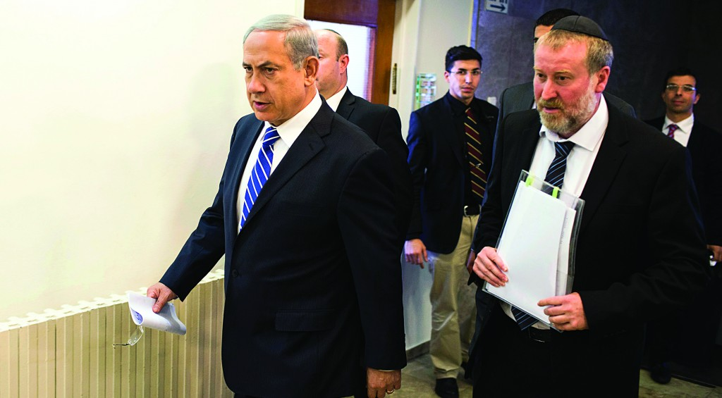 Israel's Prime Minister Binyamin Netanyahu (L) arrives for the weekly cabinet meeting on Sunday, at which he said Israel said it carried out an air strike against Gaza terrorists. (REUTERS/Ilia Yefimovich/Pool)