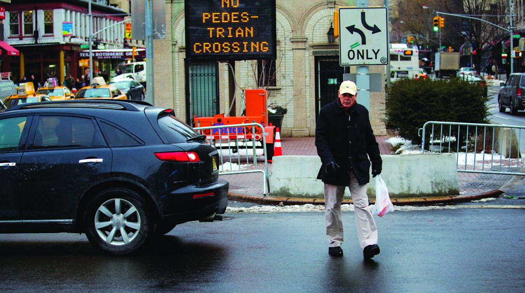 A pedestrian on Monday jaywalks at the busy intersection of W. 96th Street and Broadway in the Upper West Side. (AP Photo/Craig Ruttle)