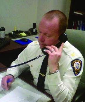 Lakewood Police Captain Gregory Meyer handles calls from his office on Friday. (TheLakewoodScoop.com)