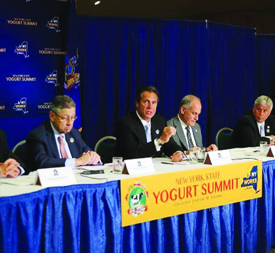 """Governor Andrew Cuomo at a """"yogurt summit"""" he held on Aug. 15, 2012, to boost New York's dairy industry. (Office of the Governor)"""