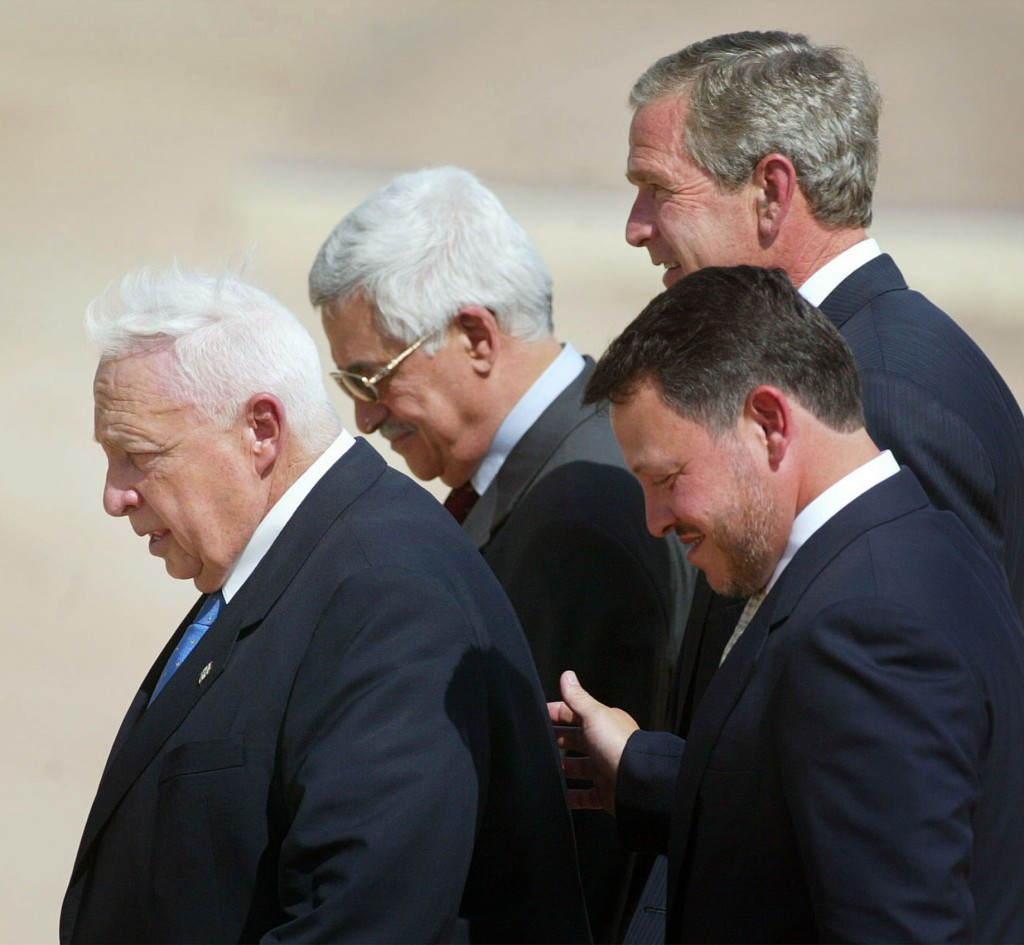 This Wednesday, June 4, 2003 file photo, from left to right shows, Israeli Prime Minister Ariel Sharon, Palestinian Prime Minister Mahmoud Abbas, King Abdullah of Jordan and President Bush, walk off stage after making statements after their meeting at Beit al Bahar Palace, in Aqaba, Jordan. (AP Photo/Pablo Martinez Monsivais, File)