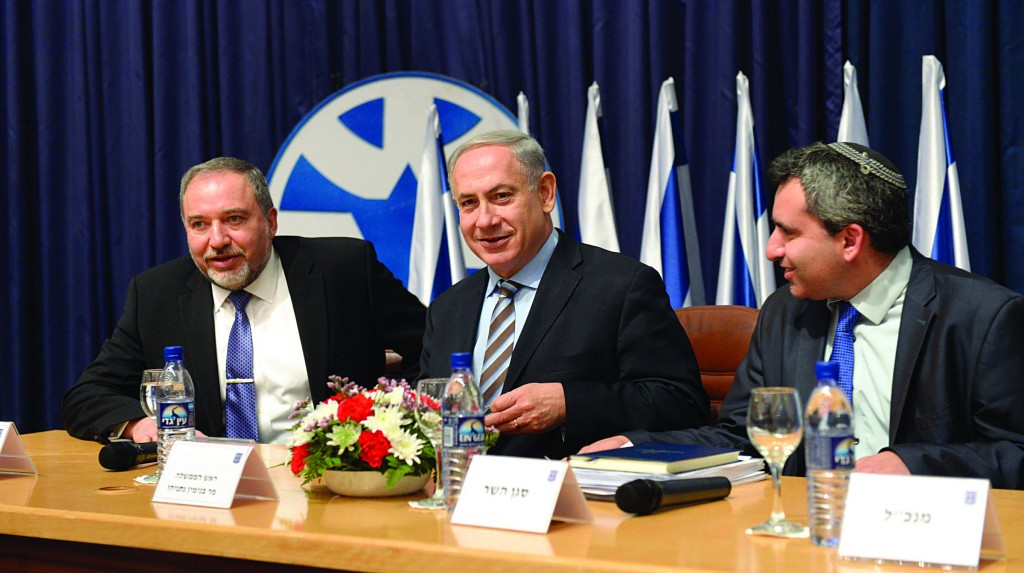 Israeli Prime Minister Binyamin Netanyahu (C), flanked by Foreign Minister Avigdor Lieberman (L) and Ze'ev Elkin this week. (Amos Ben Gershom/GPO/FLASH90)