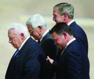 This June 4, 2003 file photo, from left to right shows, Israeli Prime Minister Ariel Sharon, Palestinian Prime Minister Mahmoud Abbas, King Abdullah of Jordan and President Bush, walk off stage after making statements after their meeting at Beit al Bahar Palace, in Aqaba, Jordan. (AP Photo/Pablo Martinez Monsivais, File)