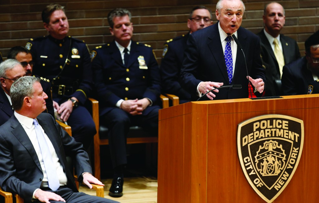Mayor Bill de Blasio (L) listens Thursday to remarks by newly-sworn in Police Commissioner William J. Bratton during a ceremony at police headquarters. (AP Photo/Kathy Willens)