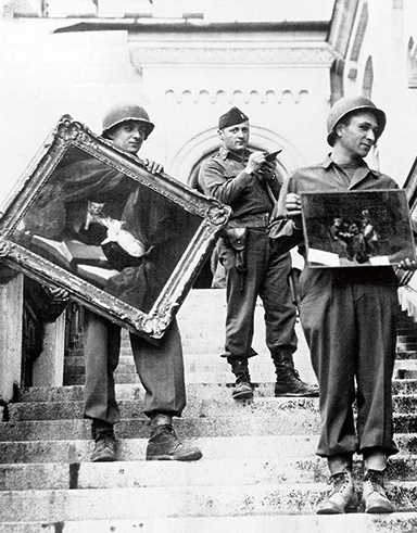 U.S. soldiers carry rescued paintings down the steps of Neuschwanstein Castle in Bavaria in 1945. (National Archives and Records Administration)