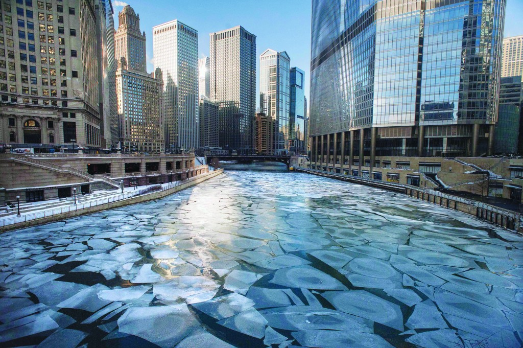 Ice floats in the frozen Chicago River as seen from the Michigan Avenue Bridge in Chicago, Monday morning. Below-zero high temperatures expecting to last 2 1/2 days have returned to many parts of the Midwest, bringing with them wind chills ranging from the negative teens to temperatures colder than 40 below zero. (AP Photo/Sun-Times Media, Michael R. Schmidt)