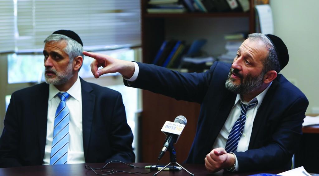 Shas chairman Aryeh Deri (R) and Shas MK Eli Yishai (L). (Yonatan Sindel/Flash90)