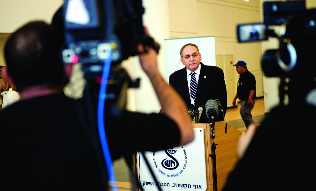 Dr. Zeev Rotstein, director of Sheba Medical Center, where the comatose former Israeli prime minister Ariel Sharon is being treated, informs the media about Sharon's deteriorating health condition. (AP Photo/Dan Balilty)
