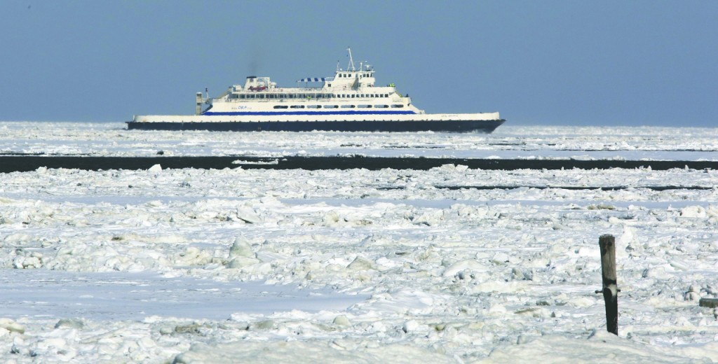 A ferry steams into ice-choked Cape May Canal, off Lower Township, N.J., Wednesday. (AP Photo/The Press of Atlantic City, Dale Gerhard)