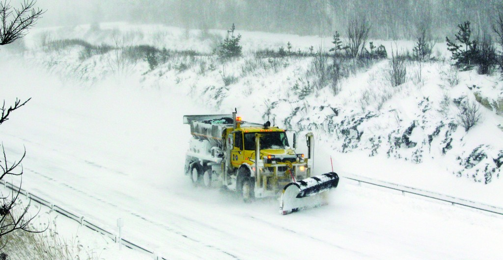 A plow moves along a empty stretch of the New York State Thruway Tuesday.