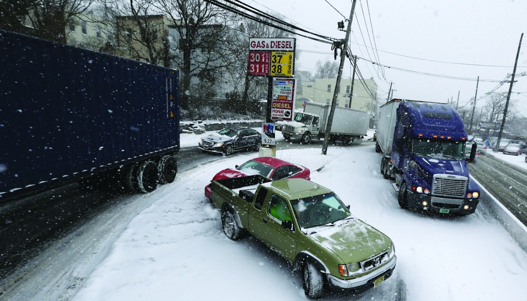A two-vehicle accident blocks Highway 1 & 9, Tuesday in Jersey City, N.J. (AP Photo/Julio Cortez)