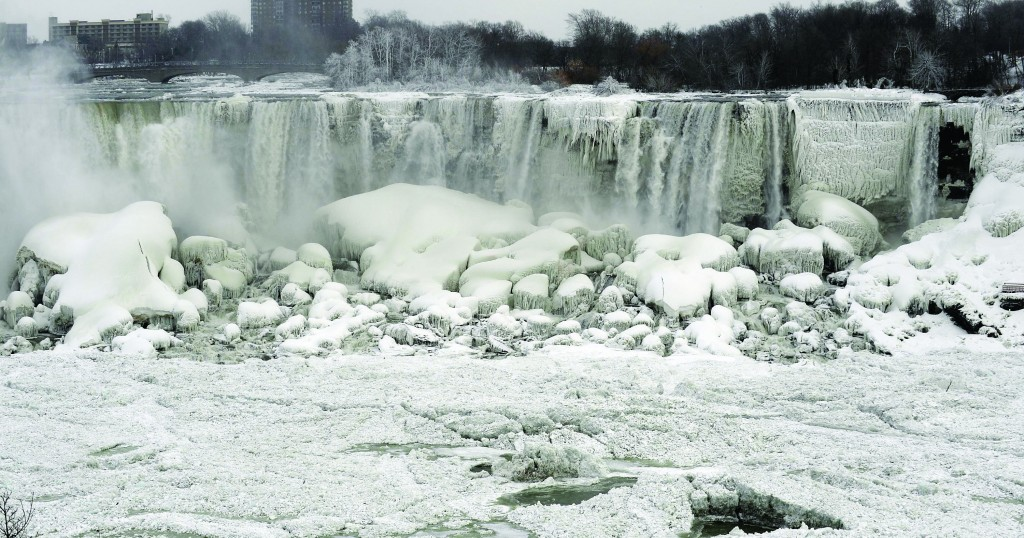 A mixture of water and chunks of ice pour down the U.S. side of Niagara Falls, Wednesday.