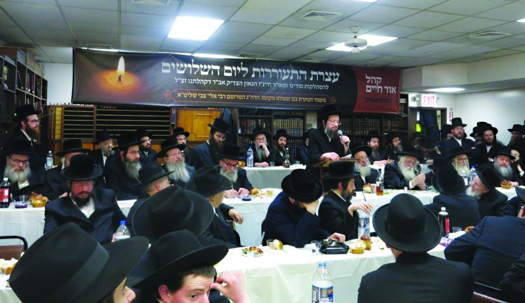"At the sheloshim Wednesday of Harav Avrohom Chaim Spitzer, zt""l, Rav of Khal Ohr Hachaim in Boro Park, his son Harav Eliyahu Tzvi Spitzer (speaking) was appointed as his successor. Dozens of Rebbes and Rabbanim attended the event in the shul. (JDN)"