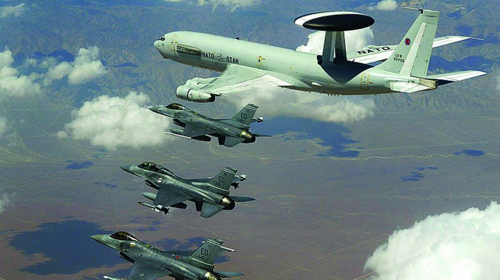 NATO E-3 AWACS flying with three American Air Force F-16 Fighting Falcon fighter aircraft in a NATO exercise.