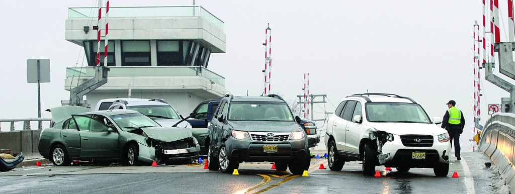 Some of the vehicles involved Friday in a 12-car accident at the Beaver Dam bridge in Brick Township, N.J. (AP Photo/The Asbury Park Press, Thomas P. Costello)
