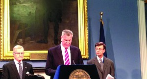 Mayor Bill de Blasio discusses the weather Tuesday morning in City Hall.