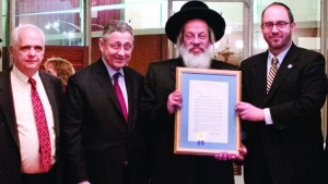 (L-R): Assemblyman Joseph Lentol; Assembly Speaker Sheldon Silver, Harav Samuel Weissmandl (son of Harav Michoel Ber Weissmandl) and Sen. Simcha Felder outside the Assembly Chamber. (New York State Assembly)