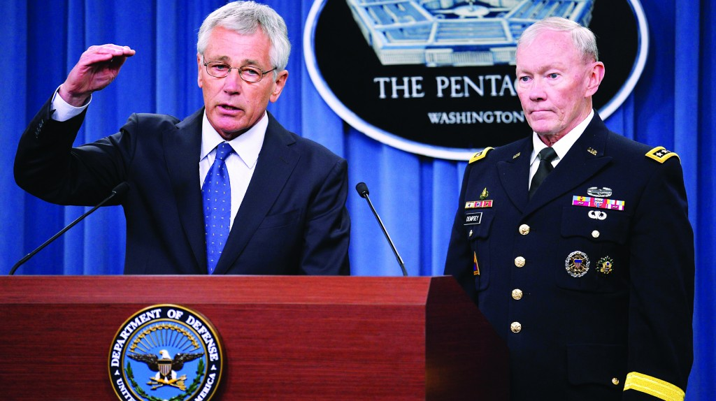 U.S. Secretary of Defense Chuck Hagel (L) makes remarks to the press as Chairman of the Joint Chiefs of Staff General Martin Dempsey listens at the Pentagon, Arlington, Virginia, Monday. (REUTERS/Mike Theiler)